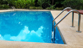 Swimming pool with stairs. Royalty Free Stock Photos