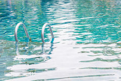 Swimming pool with stairs Royalty Free Stock Photo