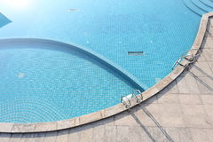 Swimming pool with stairs Stock Image