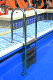 Swimming pool stairs Stock Photo