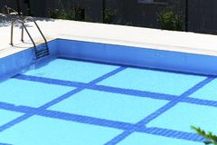 Swimming pool with stairs on a sunny day stock photo