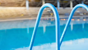 Swimming pool stairs for swimmers safety Stock Images