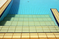 Swimming pool stairs, water & tiles Royalty Free Stock Photo
