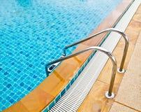 Swimming pool stairway Stock Photo