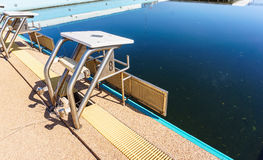 Swimming pool starting block outdoor abandoned Royalty Free Stock Photos