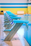 Swimming pool with starting blocks Royalty Free Stock Image