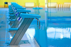 Swimming pool with starting blocks Royalty Free Stock Photos