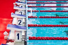 Swimming pool starting blocks Royalty Free Stock Photos
