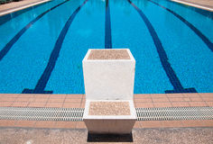 Swimming pool and starting places at sport center Stock Images