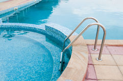 Swimming pool steps Stock Photo