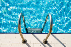 Swimming pool steps. (abstract beautiful photo Royalty Free Stock Photo