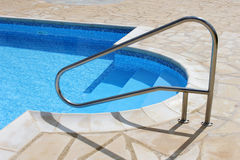 Swimming pool steps Royalty Free Stock Images