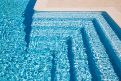 Swimming pool steps Royalty Free Stock Image