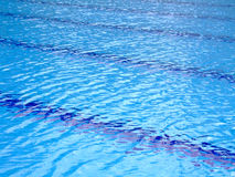 Swimming pool stripes. Trembling surface of an Olympic size swimming pool Stock Photo