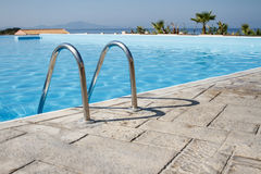 Swimming pool in a summer resort Royalty Free Stock Images