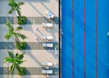 Swimming Pool and Sun beds Stock Image