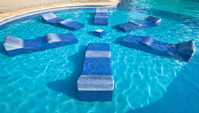 Swimming pool sun beds Royalty Free Stock Photo