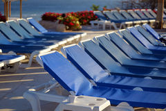 Swimming pool with sun beds Stock Photos