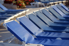 Swimming pool with sun beds Stock Images