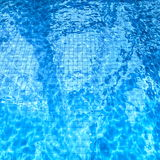 Swimming pool with sun glare on the water Royalty Free Stock Photography