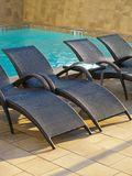 Swimming Pool Sun Lounger Stock Images