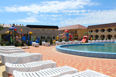 Swimming pool with sun loungers on the territory of the tourist complex. UCRAINE, ZATOKA, - may 27: Swimming pool with sun loungers on the territory of the royalty free stock photo