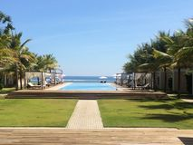 Swimming pool in paradise stock photography