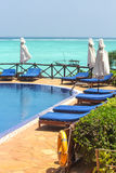 Swimming pool with sunbeds and umbrellas Royalty Free Stock Photography
