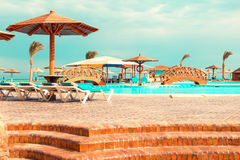 Swimming pool with sunbeds and umbrellas, Egypt royalty free stock images