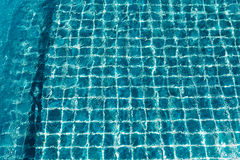 Swimming pool with sunny reflection Royalty Free Stock Image