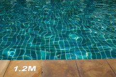Swimming pool with sunny reflections Stock Photography
