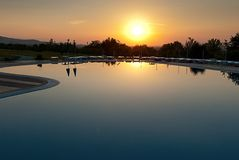 Swimming pool in sunrise Stock Photo