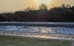 Swimming pool in sunrise stock photos