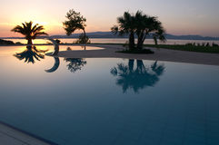 Swimming pool sunset Stock Photo