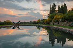 Swimming pool at sunset. In Tuscany, Italy Royalty Free Stock Photography