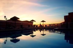 Swimming pool at sunset. View on swimming pool with sky reflection at sunset Royalty Free Stock Image