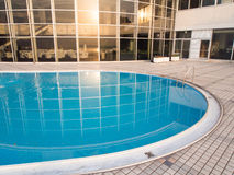 Swimming pool at sunset. Swimming pool with blue water at sunset Royalty Free Stock Photo