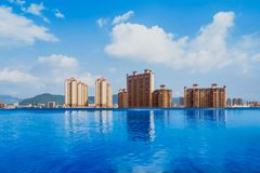 Swimming Pool, Sunset, Dating, Poolside, Flirting. The swimming pool on the top of building of hotel,Guangzhou City Royalty Free Stock Photos
