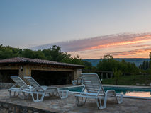 Swimming pool sunset Royalty Free Stock Image