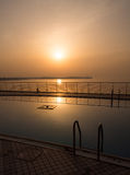 Swimming pool at sunset. Swimming pool near the sea at sunset Royalty Free Stock Photo