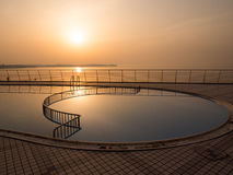 Swimming pool at sunset. Swimming pool near the sea at sunset Royalty Free Stock Photos