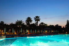 Swimming pool and sunset at popular hotel Stock Images
