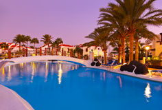 Swimming pool at sunset. Vacation background Stock Image