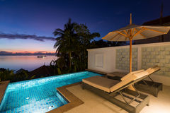 Swimming pool with sunset view Royalty Free Stock Images