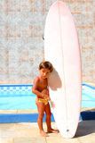 Swimming Pool Surf Boy. Boy holding a Surf board on the swimming pool Stock Photo