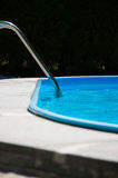 Swimming Pool. Swiming pool with stainless steel stairs and clear blue water Stock Photo