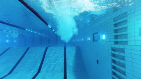 Swimming pool. Swimmer diving into the water. Swimming pool, underwater shot stock footage