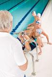 Swimming pool - swimmer training competition. In class with coach Royalty Free Stock Photography