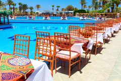 Swimming pool with tables Stock Photography
