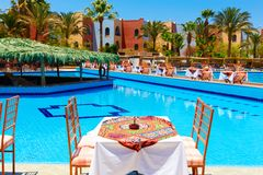 Swimming pool with tables Stock Image